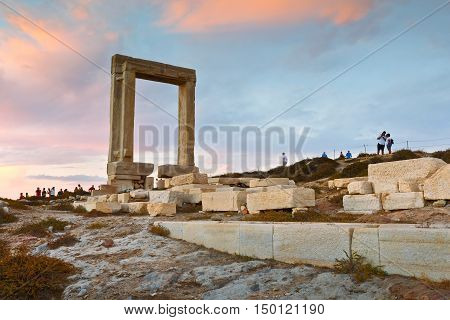NAXOS, GREECE - SEPTEMBER 21, 2016: View of Portara and remains of temple of Apollo at sunset on September 21, 2016.