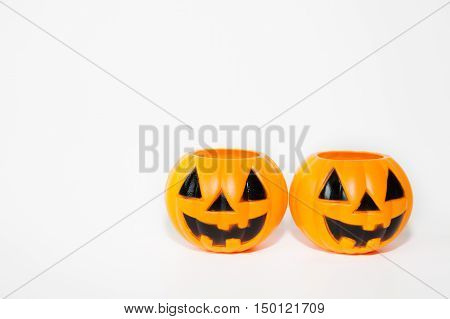 Two Orange Jack-o-lantern Bucket Pumpkins In White Isolated Background