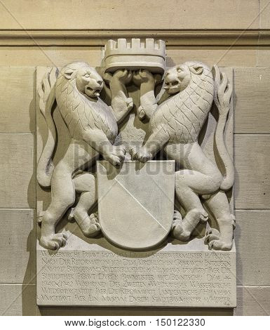 Zurich, Switzerland - 3 October, 2016: relief on the wall of the Water Church (German: Wasserkirche), at the entrance to it. The Water Church is a church built on a small island in the Limmat river.