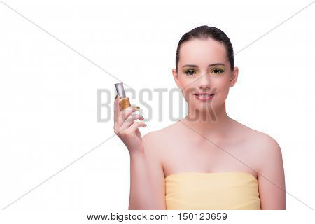 Young woman with polish bottle isolated on white