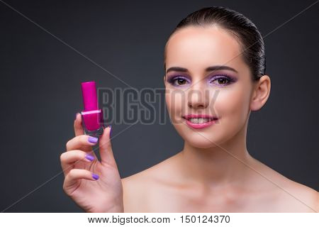 Woman with bottle of manicure polish