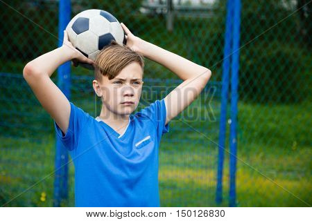 Boy throws a ball out on the field