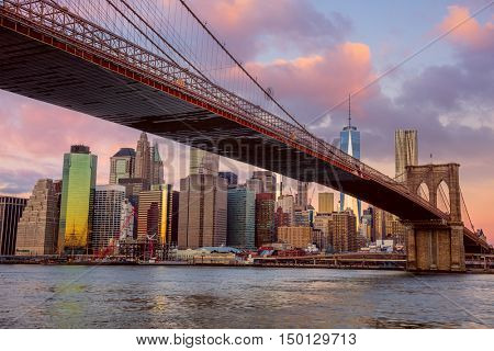 Sunrise view of  Brooklyn Bridge and Lower Manhattan skyline in New York City with gentle morning colors, USA
