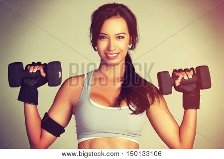 Beautiful latin woman lifting weights