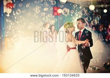 Wedding dance with smoke and bubbles at wedding