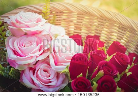 fake roses in basket, wedding concept with warm light