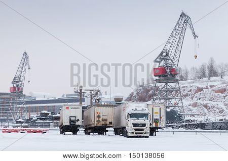 Cranes And Trucks In Port Of Turku