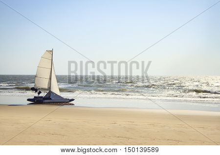 catamaran yacht standing on a deserted beach