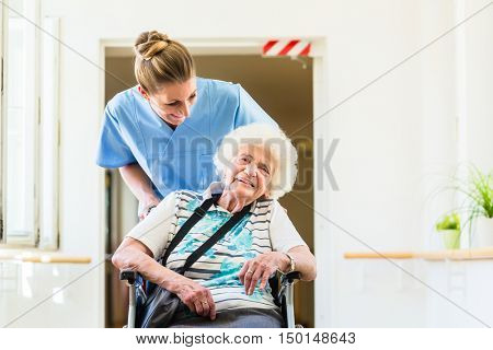Caregiver with senior patient in wheel chair