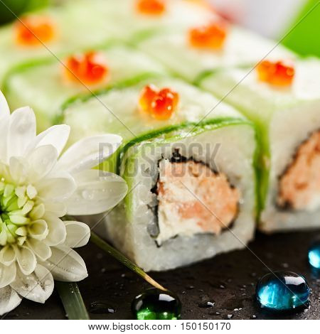 Maki Sushi - Rolls with Fried Salmon and Cream Cheese insisde. Cucumber outside. Topped with Salmon Caviar