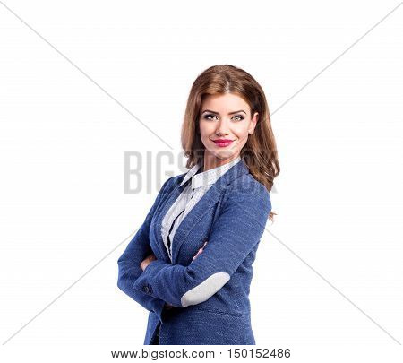 Young beautiful woman in white dotted blouse and blue jacket, arms crossed. Studio shot on white background, isolated.