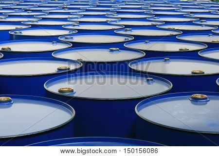 metal barrels of blue color on a white backgroun