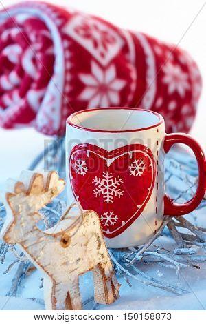 Christmas decoration with reindeer, mug and blanket.