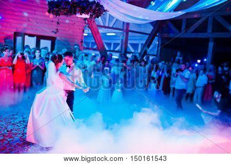 Wedding Dance In Restaurant With Varioius Lights And Smoke