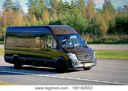 PAIMIO, FINLAND - SEPTEMBER 30, 2016: United Parcel Service Inc UPS delivery van moves along motorway in Paimio. Founded in 1907 UPS is the worlds largest package delivery company.