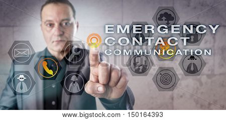 Corporate executive is reaching out for an EMERGENCY CONTACT COMMUNICATION onscreen. Information technology and cybersecurity concept for the execution of a prepared and effective incident response.