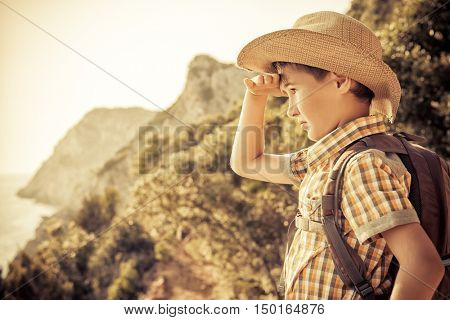 Happy boy spends the summer holidays at the seaside. Outdoor activities, tourism and adventure.