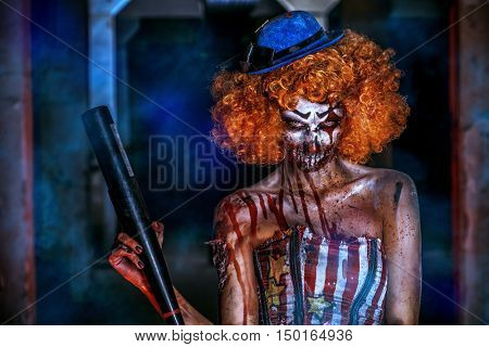 Evil clown murderer stained in blood. Female zombie clown. Halloween. Horror.