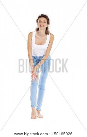 Happy brunette girl in white t-shirt and blue jeans, isolated on white background