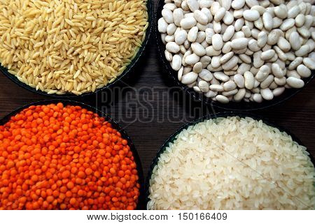 various cereals and legumes in bowls, Rice, Lentils, barley noodles and haricot bean