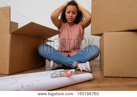 Desperate And Tired Woman During Home Relocation