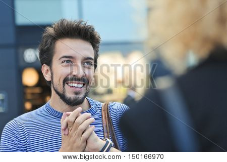 Smiling man talking with someone