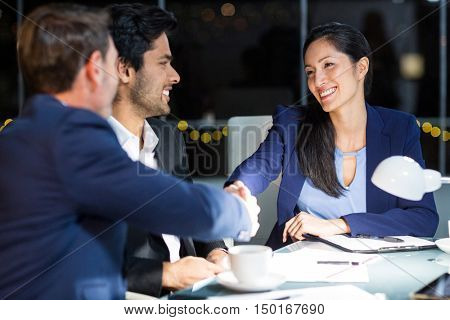 Businessman shaking hands with a colleague in the office