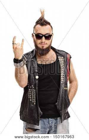 Young punker doing a rock hand gesture isolated on white background