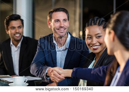 Businessman shaking hands with colleague in the office