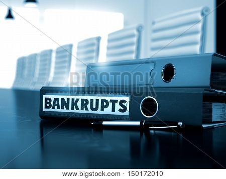 Office Folder with Inscription Bankrupts on Office Working Desktop. Bankrupts - Office Binder on Working Desk. Bankrupts - Illustration. Bankrupts. Illustration on Blurred Background. 3D.