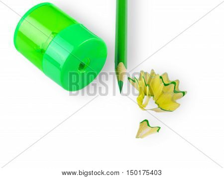 sharpener green wooden pencil and pencil shavings on white background