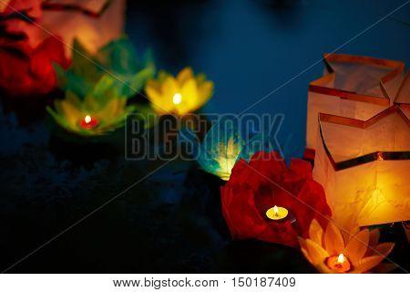 Paper flower lanterns floating in a line at east festival