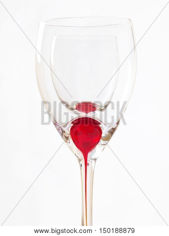 wine glass wiyh red detail isolated on white background
