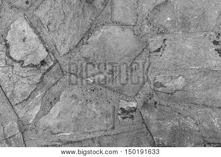 the abstract textured background or wallpaper of gray color from a shapeless stone tile