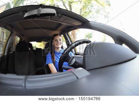 Beautiful woman driving car