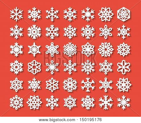 Cute snowflake collection isolated on red background. Flat snow icons snow flakes silhouette. Nice element for christmas banner cards. New year ornament. Organic and geometric snowflakes set. White snowflake icon in modern flat style