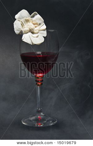 Red wine on the black background