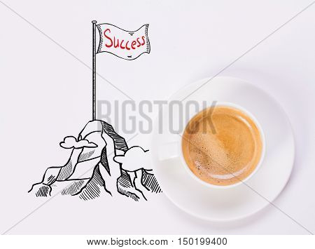 Top view of white desktop with coffee cup and creative drawing of mountain top with flag. Success concept