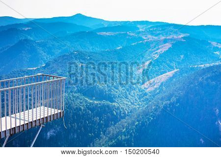 Background with Rhodope or Rodopi mountains in Bulgaria and Eagle Eye viewpoint up on the rock. Bulgarian name Orlovo Oko