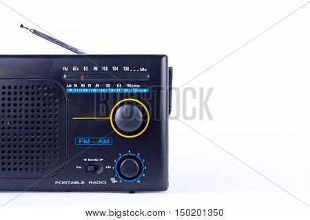 old black vintage retro style AM, FM portable radio transistor receiver on white background isolated close up