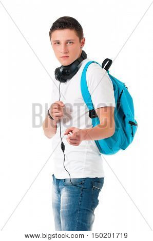 Teen student boy with headphones and backpack. Guy pointing at camera choosing you, isolated on white background. Portrait of young man pointing forefinger to front, gesture and people concept.