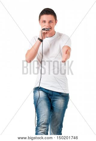 Portrait of a young man with microphone isolated on white background. Funny guy with mic in karaoke concept. Boy man holding microphone and singing or speaking.
