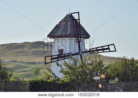 Old Stone Mill With A Thatched Roof