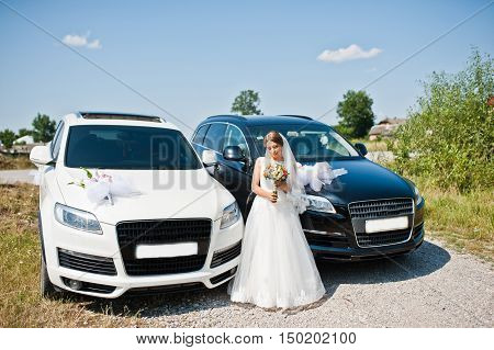 Bride With Wedding Cortege Of Two Black And White Cars