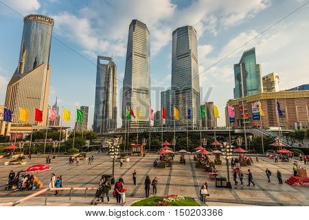 Shanghai China - October 26 2013: People walking at the Lujiazui Finance and Trade Zone Pudong Shanghai China