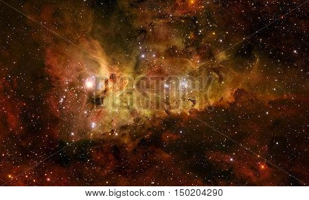 The Carina Nebula is a large bright nebula that surrounds several clusters of stars. Also known as the Eta Carinae Nebula, Grand Nebula. Retouched image. Elements of this image furnished by NASA.