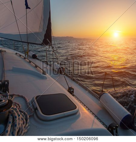 Beautiful sunset on a boat in the open sea. Luxury sailing yacht.