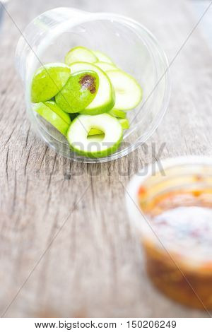 Fresh sweet and sour green sliced mango with chili paste for tropical fruit