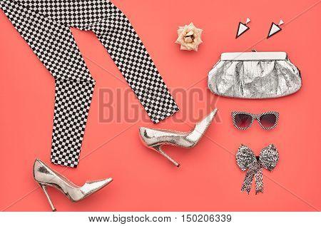 Fashion woman Clothes Accessories Set. Fashion Design.Essentials fashion. Party Silver Outfit.Stylish Leggings, Glamor fashion Heels, Handbag Clutch Trendy Sunglasses, Rose.Top view. Creative.Minimal