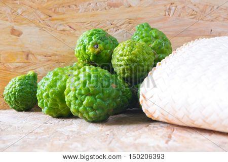 Raw Kaffir Lime (Bergamot) on wood background